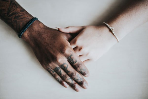 Photo of hands, holding each other in support
